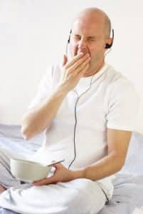 Yawning man with headphones - he needs sleep therapy!